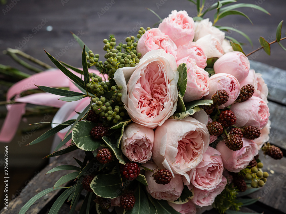 Fototapeta Beautiful wedding bouquet of shrub and peony gently pink roses.