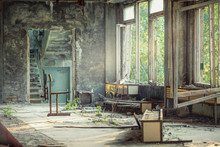 Chair And Other Broken Furniture In The Hall Of Abandoned School Number 3 Of Pripyat, Chernobyl Alienation Zone