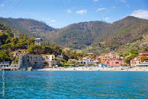 Fotobehang Mediterraans Europa Liguria, Italy coastline of Riviera with colorful houses on sunny warm day. Monterosso al Mare, Vernazza, Corniglia, Manarola and Riomaggiore, Cinque Terre National Park UNESCO World Heritage
