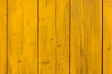 Yellow Painted Wood Texture. Wooden Fence In The Background