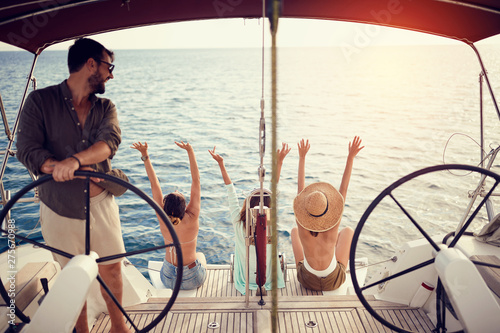Group of friends on the luxury boat together enjoy.