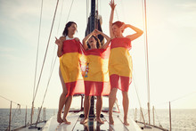 Woman On The Yacht In Spanish Flag Having Party.