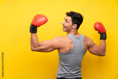 Fototapeta  Handsome sport man over isolated background with boxing gloves