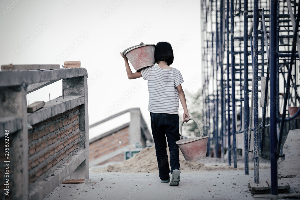 Fototapeta Children are forced to work in the construction area. Human rights concepts, stopping child abuse, violence, fear of child labor and human trafficking