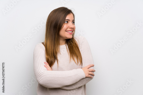 Fototapety, obrazy: Young girl with white sweater standing and looking to the side
