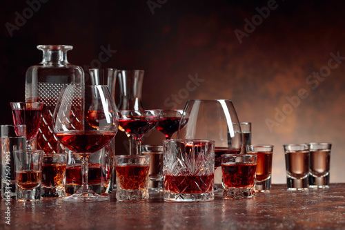 Set of strong alcoholic beverages in glasses on a brown background Canvas Print