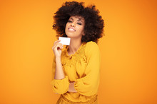 Afro Girl Holding Credit Card In Hand.