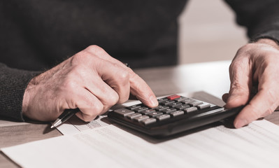 Obraz na SzkleHand using calculator, accounting concept