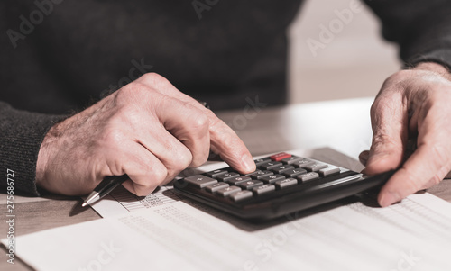 Hand using calculator, accounting concept - 275686727
