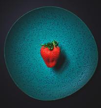 Strawberry On Ceramic Green Plate