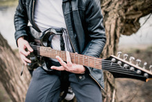 Technique Of Playing The Electric Guitar - A Man Playing Outdoors - Heavy Hard Rock And Blues Music
