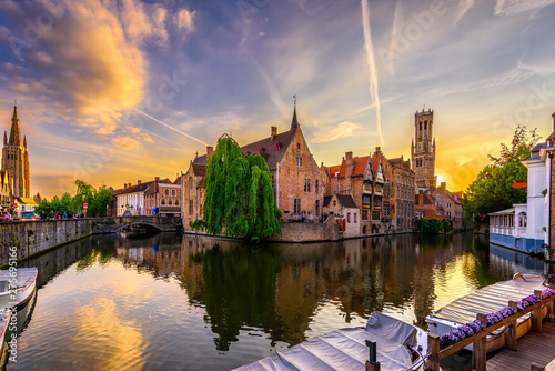 Wall Murals Bridges Classic view of the historic city center of Bruges (Brugge), West Flanders province, Belgium. Sunset cityscape of Bruges. Canals of Brugge