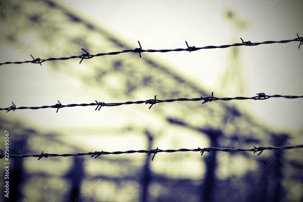 Photo  barbed wire in the concentration camp  and the background blurre