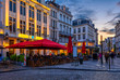 canvas print picture - Old street with tables of cafe in center of Brussels, Belgium. Night cityscape of Brussels (Bruxelles). Architecture and landmarks of Brussels.
