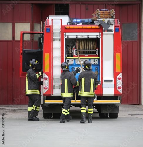 Tela  firefighters in action and the fire engine during a fire drill