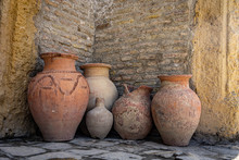 Ancient Clay Jars Against A Br...
