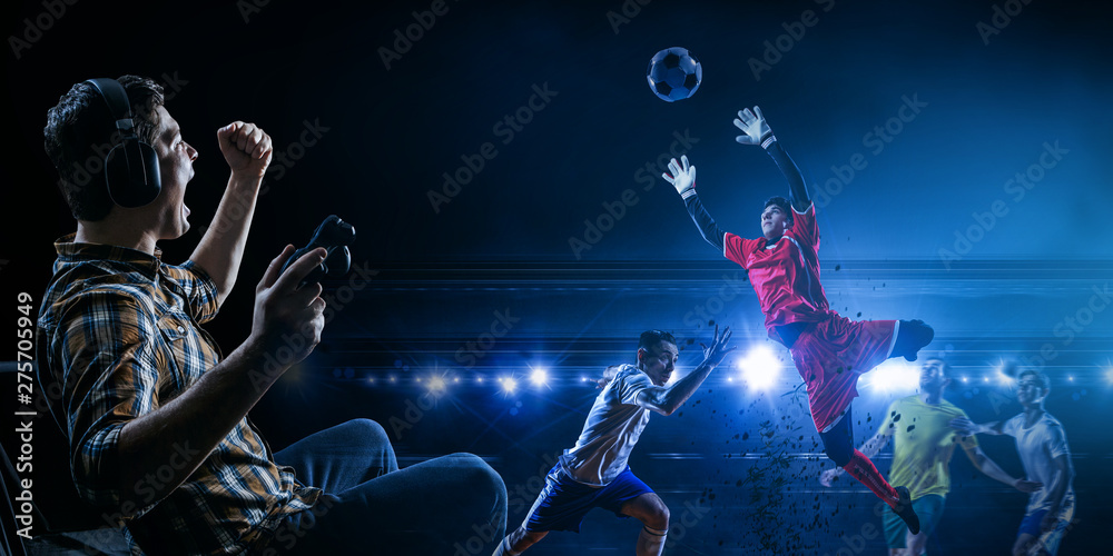 Fototapety, obrazy: Young man playing football video game