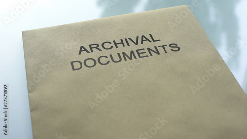 Photo Archival document, folder with important documents lying on table, close up