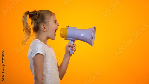 Anxious teen girl shouting in loudspeaker, relieving stress, children rights