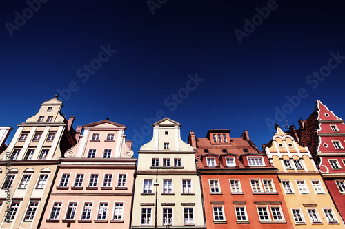Photo Stands Colourful houses, blue sky, Solny square, Wroclaw, Poland. Copy space