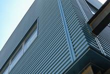Blue Metal Exterior Siding Of A Building.
