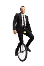 Businessman Riding A Unicycle ...