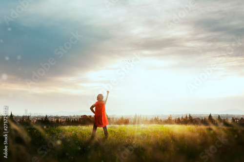 Fotomural  boy with cape playing to be super hero