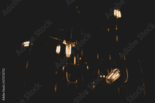 Dim vintage lightbulbs glow...