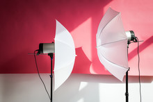 Photography Studio Flash Strobe For Light And Picture Taking On Pink Color. Tools For Professional Photographers Working In Studio.
