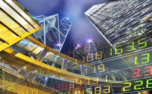 Obraz na plátně Stock Market Exchange on a skyscraper in Hong Kong at night,background