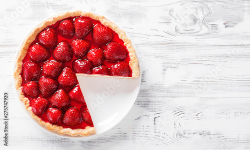 Fotografia, Obraz  Delicious strawberry tart on white wooden background, top view