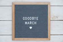 Text In English Goodbye March And A Heart Sign On A Gray Felt Board In A Wooden Frame