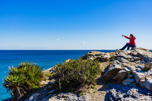 Tourist Woman On Sea Cliffs In Spain