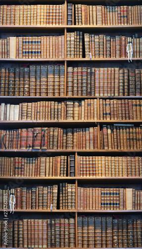 Obraz na plátně  old books on wooden shelf