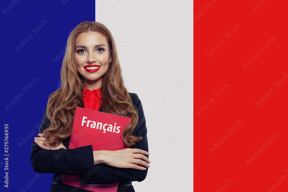 Fototapety, obrazy: Portrait of pretty young smiling woman with book on the French flag background. Travel in France and study in French language school
