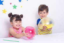 Kids Inflates A Big Bubble From A Pink And Yellow Slime. Kid Squeeze And Stretching Toy Slime.