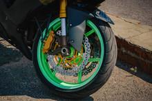 Black Sports Bike With Green Wheels Front Wheel Photo