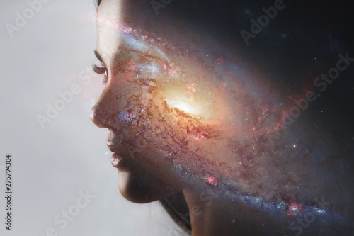 Fotografía The universe inside us, the profile of a young woman and space, the effect of double exposure