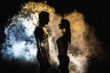 canvas print picture - The silhouette of man and woman in the smoke