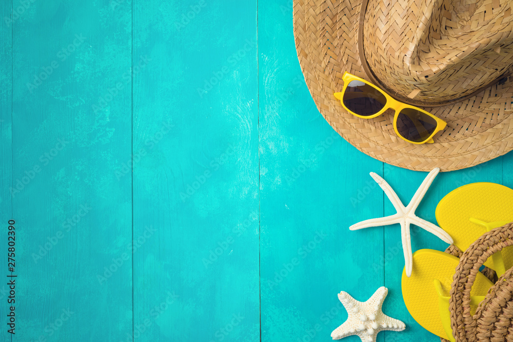 Fototapety, obrazy: Summer holiday vacation concept with beach accessories over blue wooden background. Top view from above
