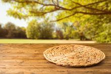 Empty Wooden Table With Wicker...