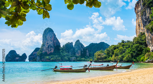 Amazing view of beautiful Ao Nang Beach with longtale boats. Location: Krabi Province, Thailand, Andaman Sea. Artistic picture. Beauty world. Panorama