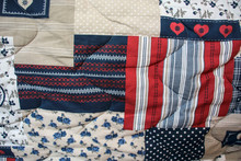Detail Of Blue And Red Patchwork Quilt With Hand Quilting