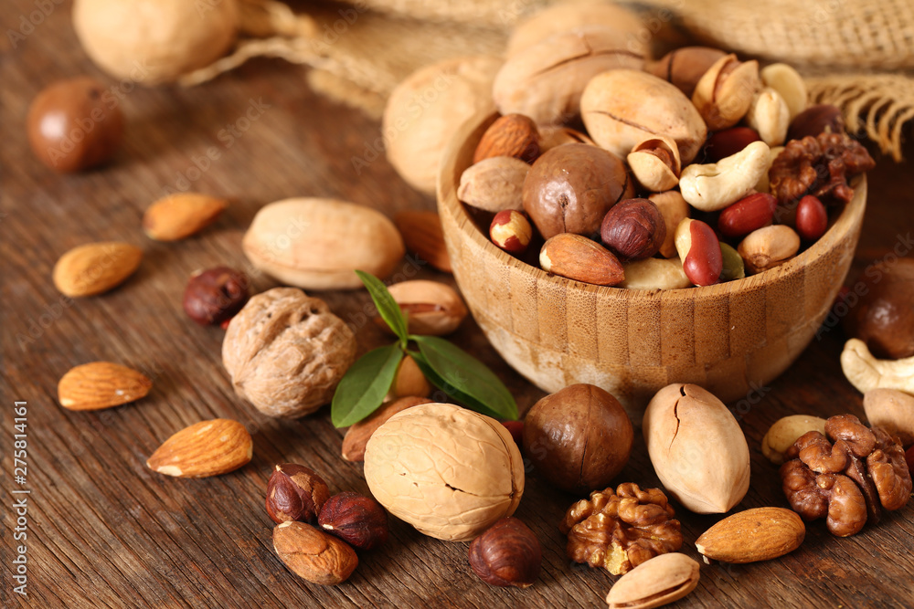 Fototapety, obrazy: organic mix nuts on a wooden table