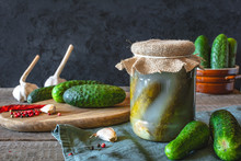 Pickled Cucumbers With Herbs And Spices On Dark Background