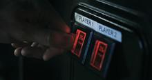 Arcade: Inserting A Quarter Into Game Slot