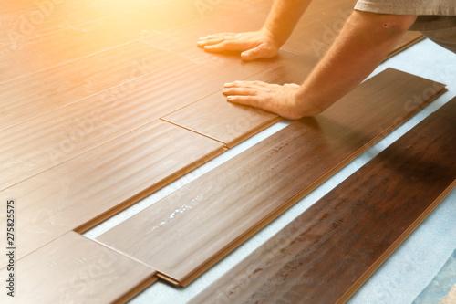 Fotografie, Obraz Man Installing New Laminate Wood Flooring