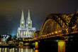 Cologne Cathedral and Hohenzollern Bridge at night in Cologne, Germany