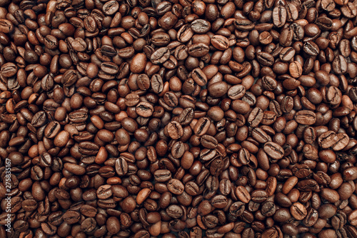 Roasted coffee beans brown seeds texture background wallpaper.