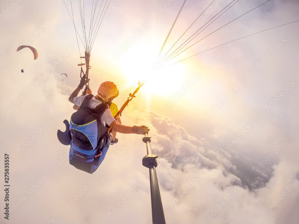 Fototapety, obrazy: Paragliding in the sky. Paraglider tandem flying over the sea with blue water and mountains in bright sunny day. Aerial view of paraglider and Blue Lagoon in Oludeniz, Turkey. Extreme sport. Landscape